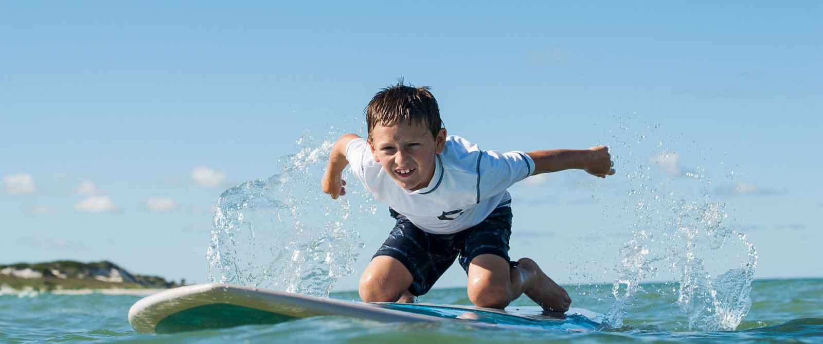 Background image of boy on paddleboard